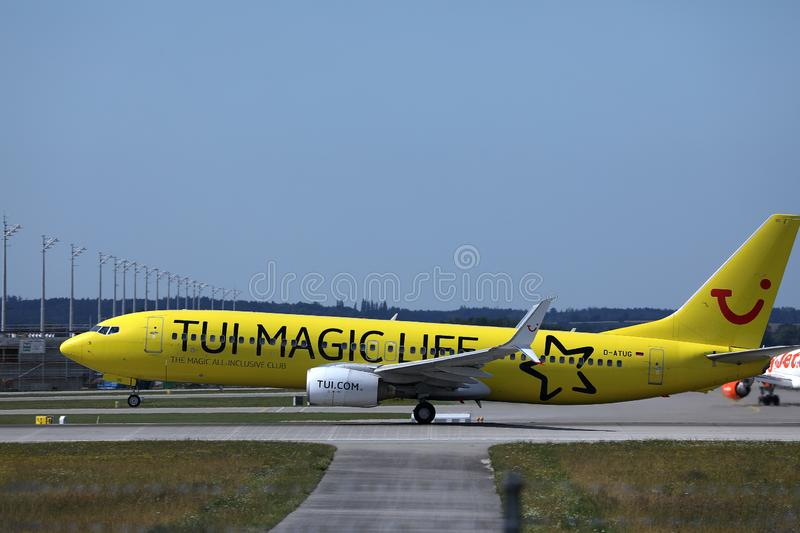 TUI Airways flying up in the sky, yellow livery. TUI Airways airplane approaching the runway. Tui magic life livery in Munich Airport MUC royalty free stock images