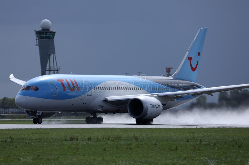TUI Airways plane landing on airport, spectacular touchdown. TUI Airways airplane flying to vacation destination, Amsterdam Airport Schiphol AMS royalty free stock image