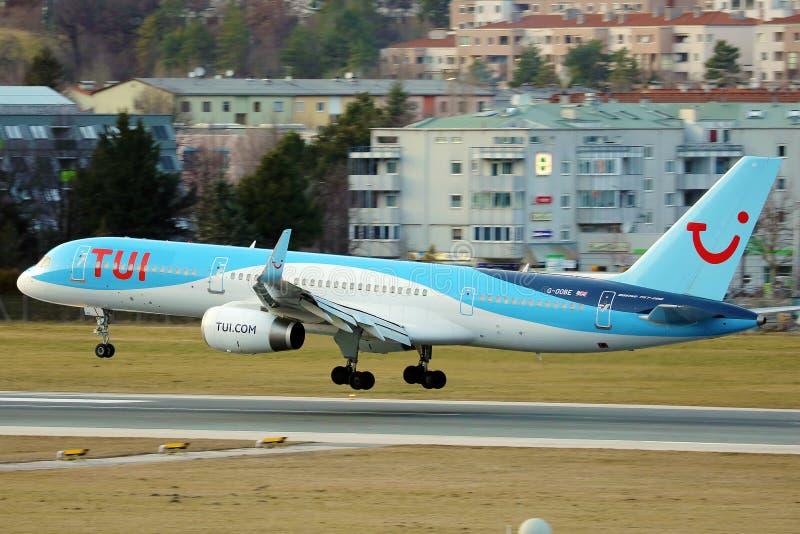 TUI Airways plane landing at Innsbruck Airport, INN stock images