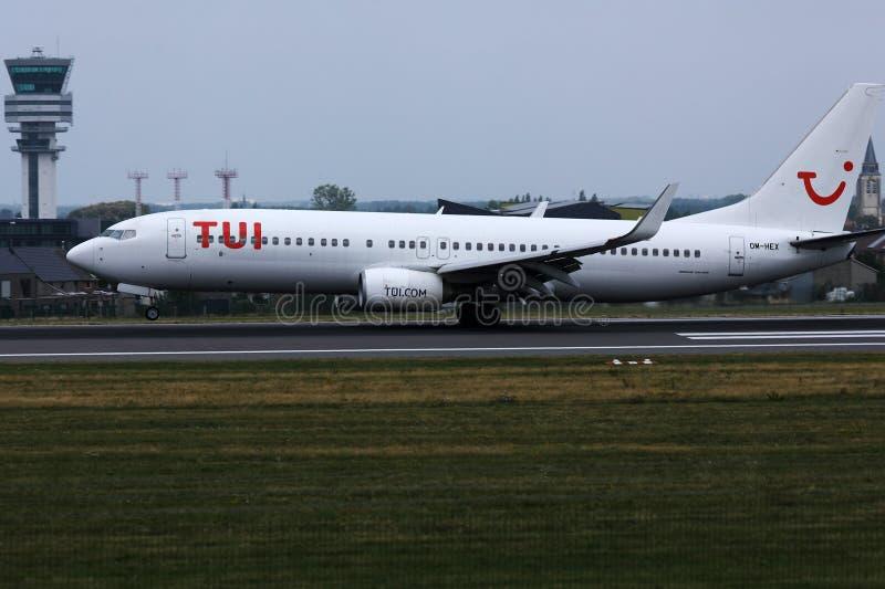 TUI Airways, white livery plane at Berlin Tegel Airport, TXL. TUI Airways, white livery airplane taxiing at Berlin Tegel Airport, TXL stock photography