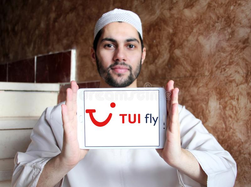 TUI fly logo. Logo of TUI fly on samsung tablet holded by arab muslim man royalty free stock photo