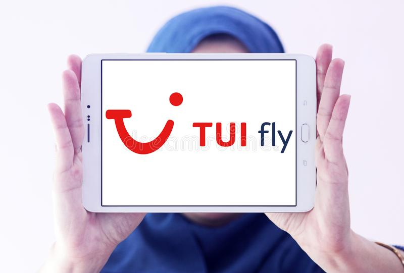 TUI fly logo. Logo of TUI fly on samsung tablet holded by arab muslim woman royalty free stock images