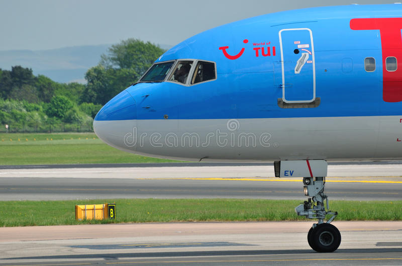 Tui Thomson Boeing 757 cockpit. Tui Thomson Boeing 757 taxiing at Manchester Airport royalty free stock images