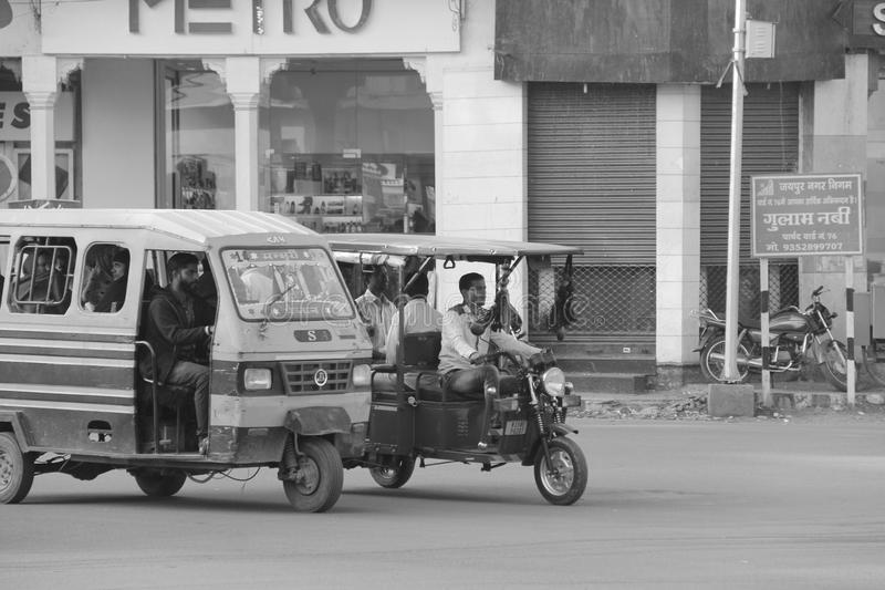 Tuk tuk car in busy traffic street in India. Tuk Tuk, also known as auto rickshaw in India is driven by old drive in the main streets of India. This is a very stock photo