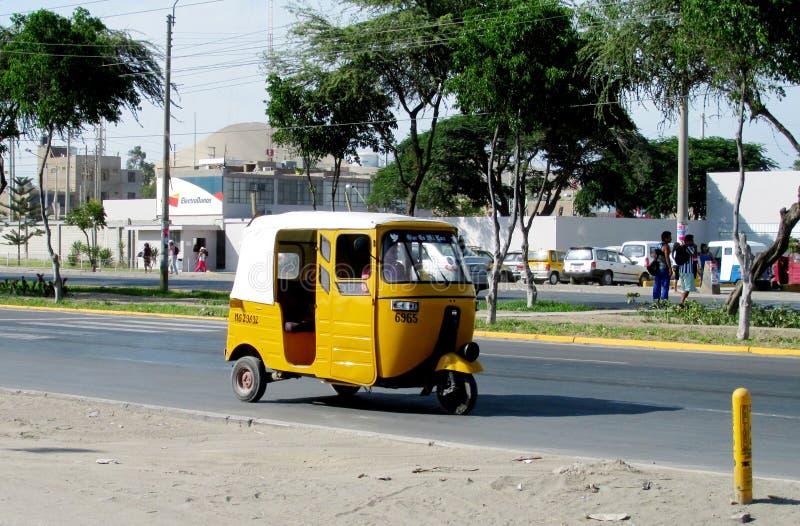 Tuk-tuk car on the street. Tuk tuk on the street in the city in Peru. Peruvian tuk tuk taxi car. Blue tuk-tuk auto royalty free stock photo