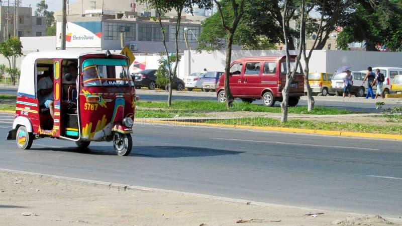 Tuk-tuk car on the street. Tuk tuk on the street in the city in Peru. Peruvian tuk tuk taxi car. Blue tuk-tuk auto royalty free stock image