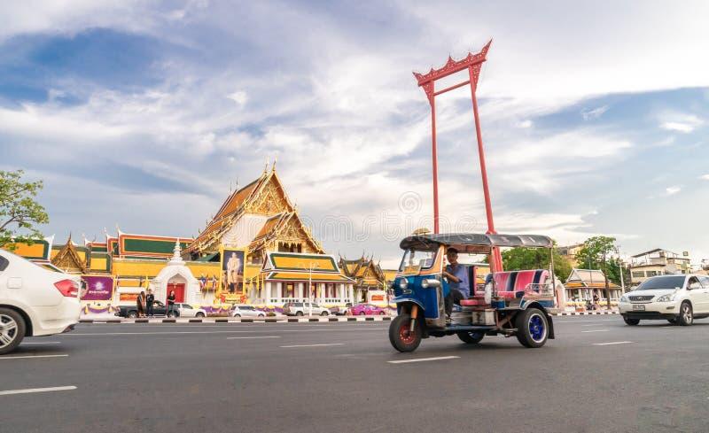 A tuk tuk car on street at the Giant swing or Sao Ching Cha the landmark of Bangkok city. Thailand: 03/07/2019. A tuk tuk car on street at the Giant swing or Sao royalty free stock photos