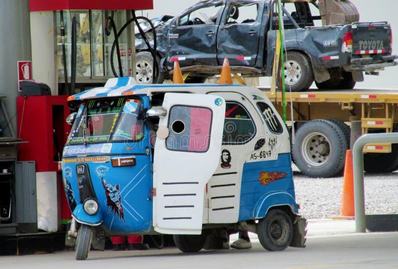 Tuk-tuk at the gas station. Tuk tuk on the street in the city in Peru. Peruvian tuk tuk taxi car. Blue tuk-tuk auto royalty free stock photos