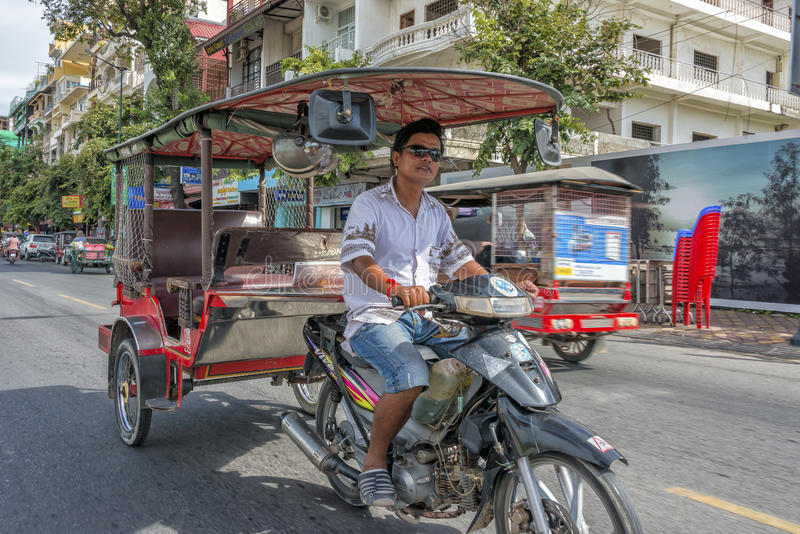 Tuk tuk Phnom Penh, Cambodia. Tuk Tuk driver on the streets of phnom penh, Cambodia. The tuktuk is a very popular way of transportation in Asia stock photos