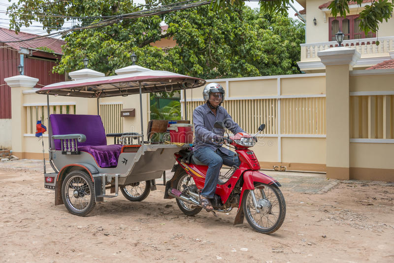 Tuk tuk Siem Reap, Cambodia. Tuk Tuk driver on the streets of Siem Reap, Cambodia. The tuktuk is a very popular method of transportation in Asia for guided tours royalty free stock images