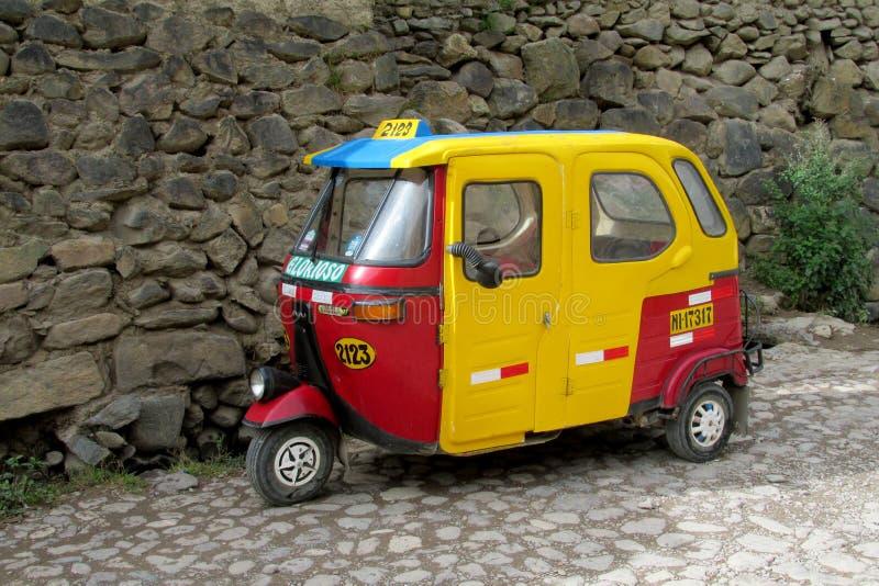 Tuk tuk taxi on the street. Tuk tuk on the street in the city in Peru. Peruvian tuk tuk taxi car. Yellow tuk-tuk auto stock images