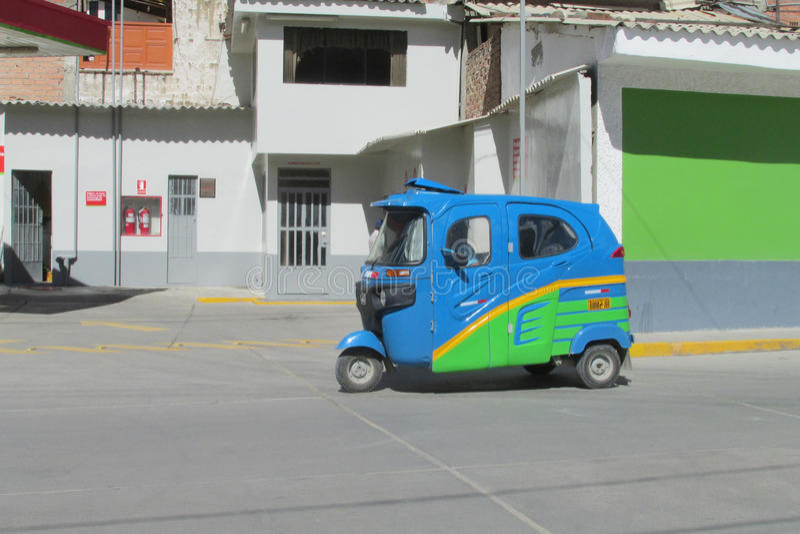 Tuk tuk taxi on the street. In the city in Peru. Peruvian tuk-tuk taxi car. Yellow tuk-tuk auto royalty free stock image
