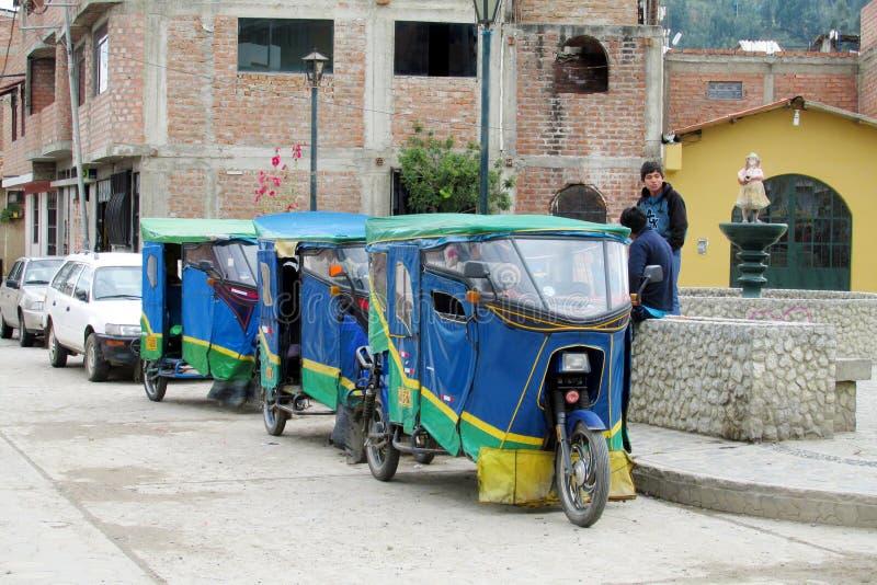 Tuk tuk taxi on the street. Tuk tuk on the street in the city in Peru. Peruvian tuk tuk taxi car. Yellow tuk-tuk auto royalty free stock images