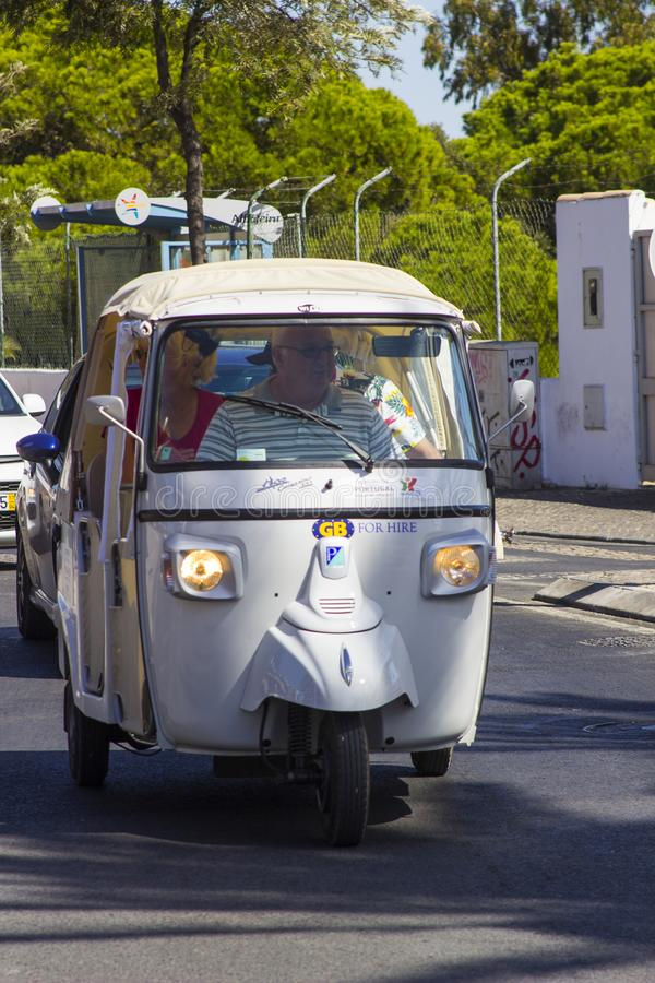 Tuk Tuk taxis on the road in Albuferia in the Portuguese Algarve stock image