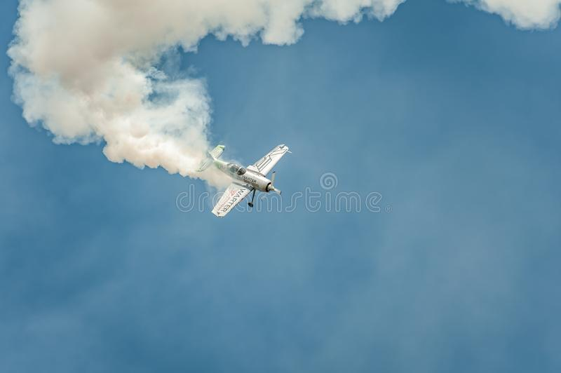 Airplane performing at airshow and shows a stunt stock image