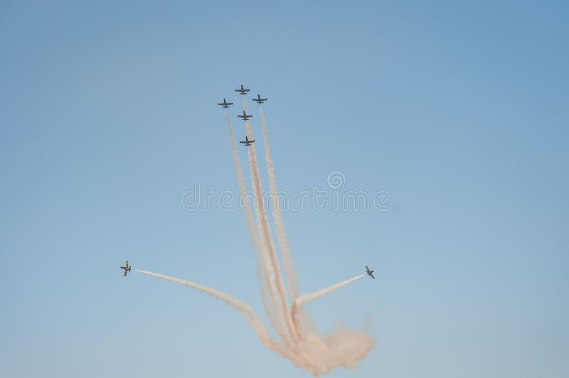 Baltic Bees team performs flight at air show and leaves behind a smokes in the sky stock photos