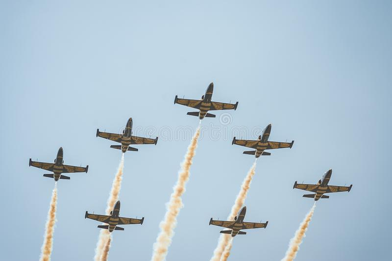 Baltic Bees team performs flight at air show and leaves behind a smokes in the sky stock photography