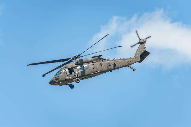 Helicopter on airshow shows its capabilities. stock image