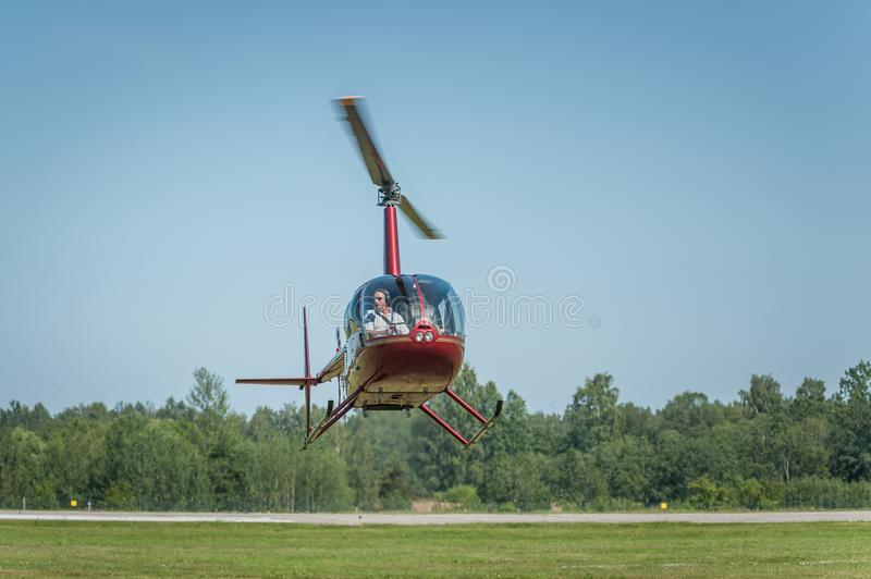 Helicopter during the take-off from the field royalty free stock image