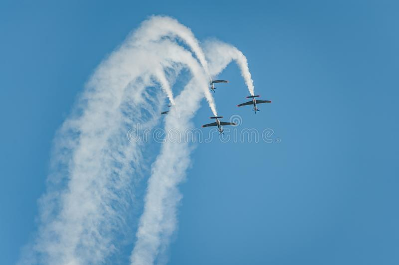 Orlik team shows great shows and leaves behind a smokes in the sky stock images