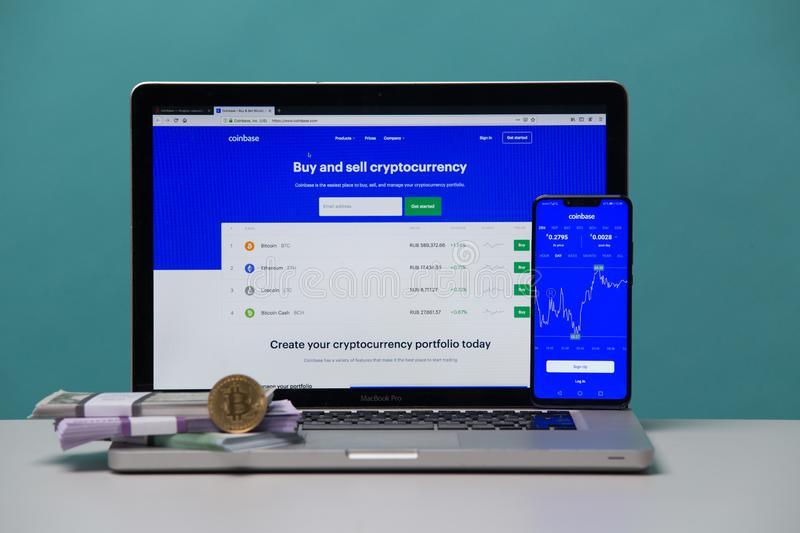 Tula, Russia 17. 06 2019 Coinbase on the laptop and phone display. royalty free stock photos