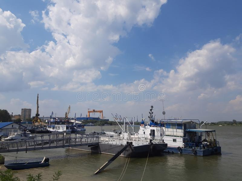 Landscape of Tulcea harbor! Boats on water! stock photo