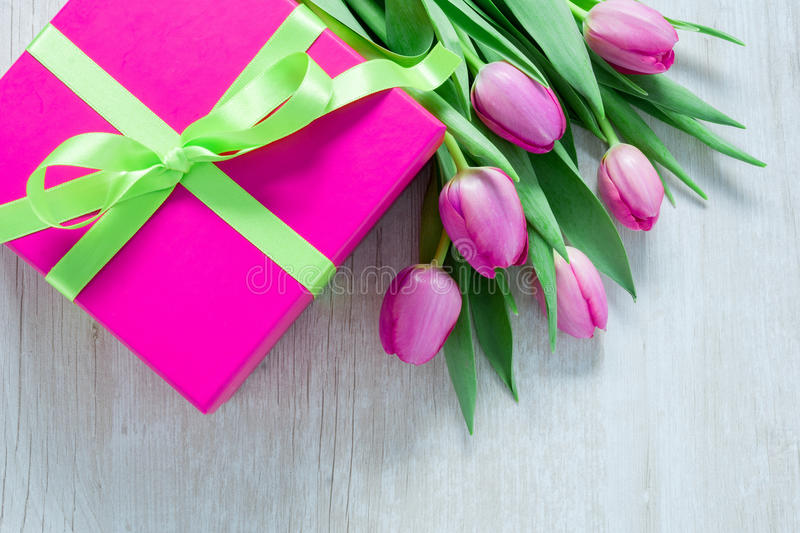 Tulip Flowers and Giftbox on rustic table for March 8, International Womens Day, Birthday , Valentines Day or Mothers day - Top V royalty free stock photography