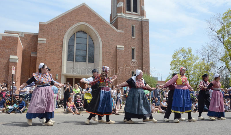 Tulip Time Festival dancers in front of church. HOLLAND, MI - MAY 3: Tulip Time Festival dancers perform a mother-daughter dance in Holland, MI May 3, 2015 royalty free stock image