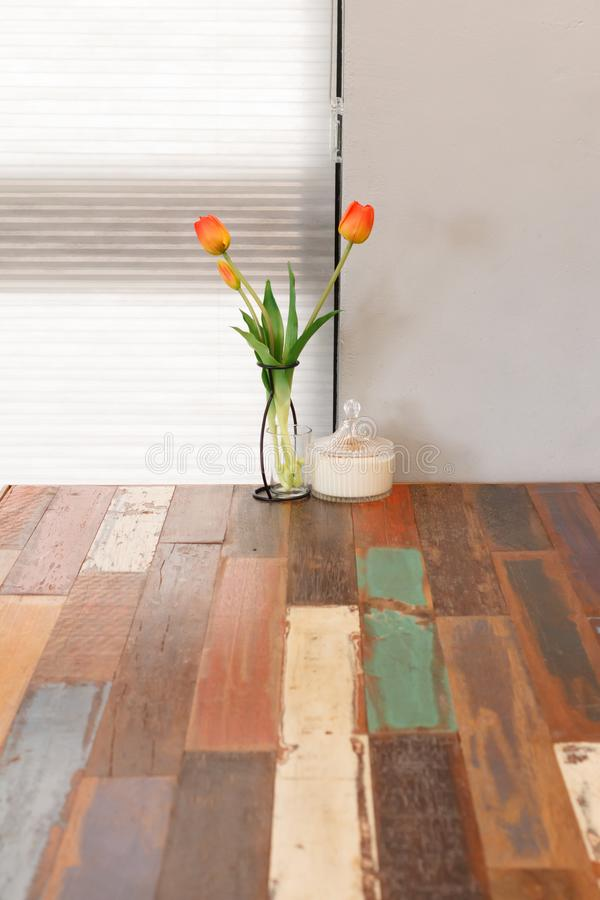 Tulip on the wooden table, interior of restaurant or cafe. Tulip flower on the wooden table, interior of restaurant or cafe royalty free stock photos