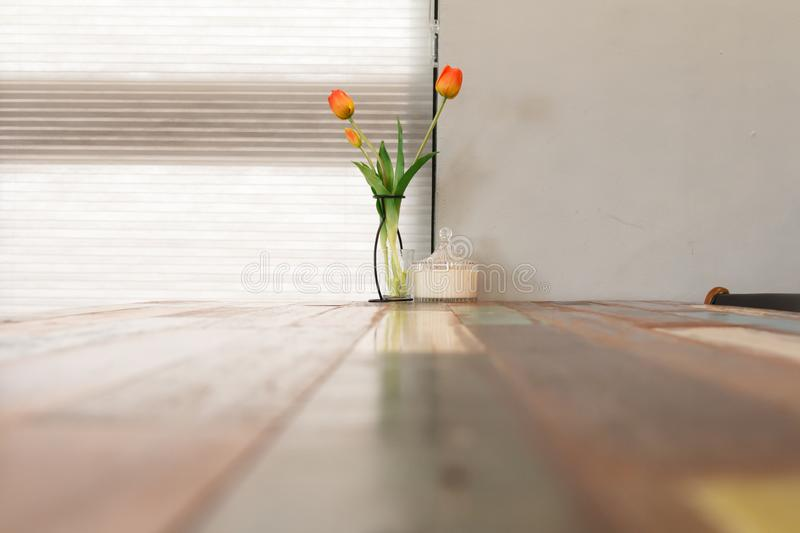Tulip on the wooden table, interior of restaurant or cafe. Tulip flower on the wooden table, interior of restaurant or cafe stock image