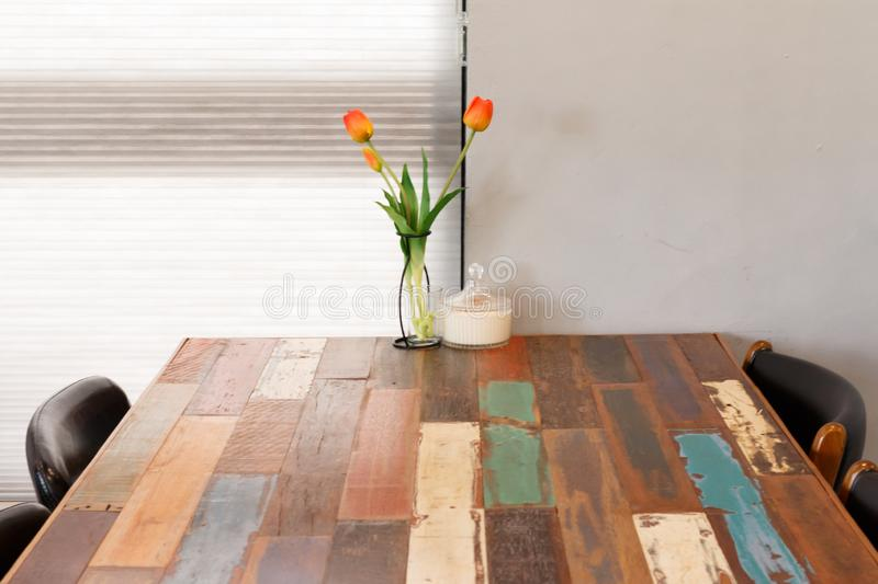 Tulip on the wooden table, interior of restaurant or cafe. Tulip flower on the wooden table, interior of restaurant or cafe stock images