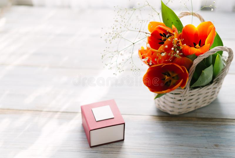 Download Tulips In A Basket On A White Wooden Background Stock Image - Image of date, flower: 111619727