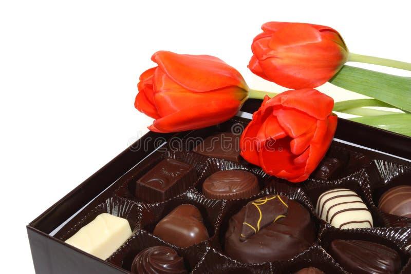 Tulips e chocolate imagens de stock royalty free