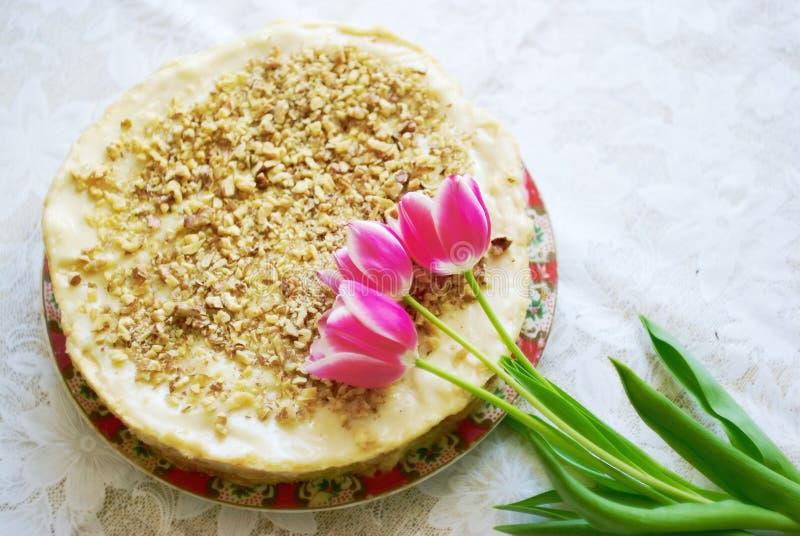Download Tulips flowers and cake stock image. Image of seasonal - 22978699