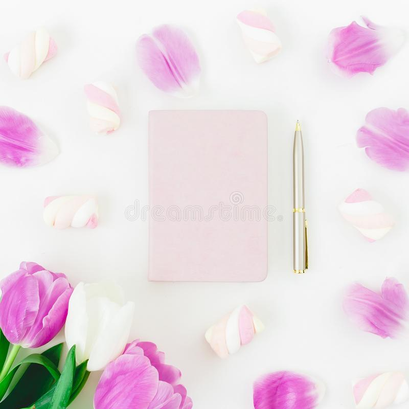 Tulips flowers and marshmallow with dairy and pen on white background. Flat lay, Top view. Tulip flower and candy royalty free stock photos