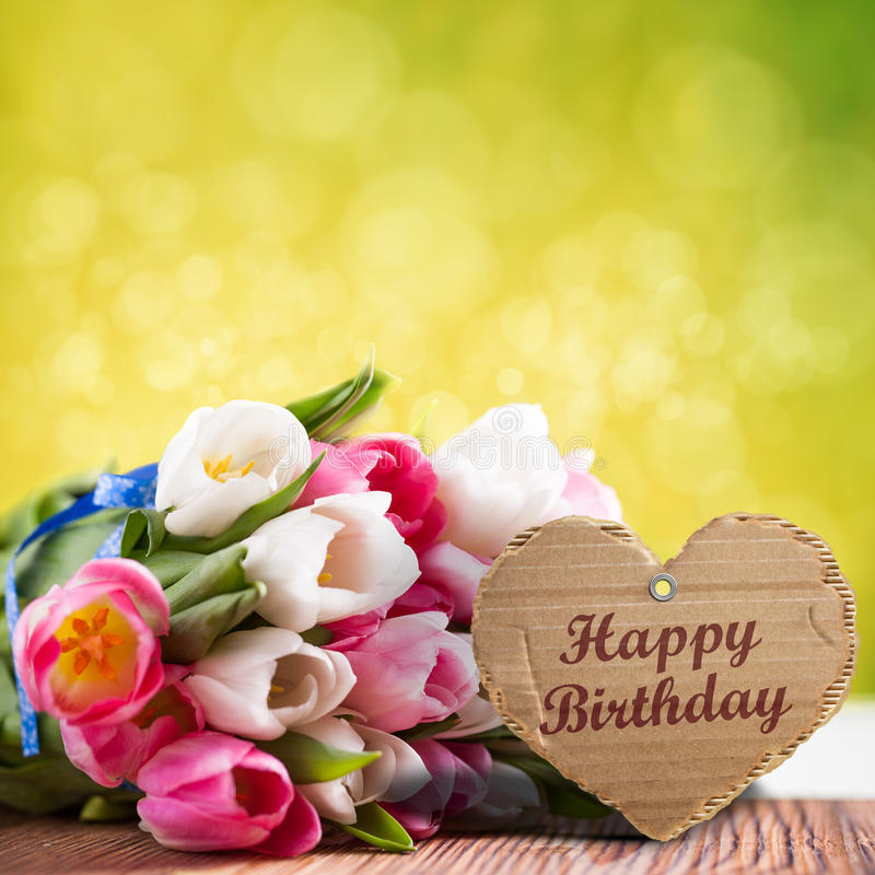 Tulips with message saying `Happy birthday` royalty free stock image
