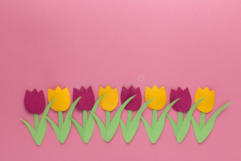Red and yellow tulips on pink background, one line. Tulips of paper, decor for postcard,woman day, march, spring royalty free stock image