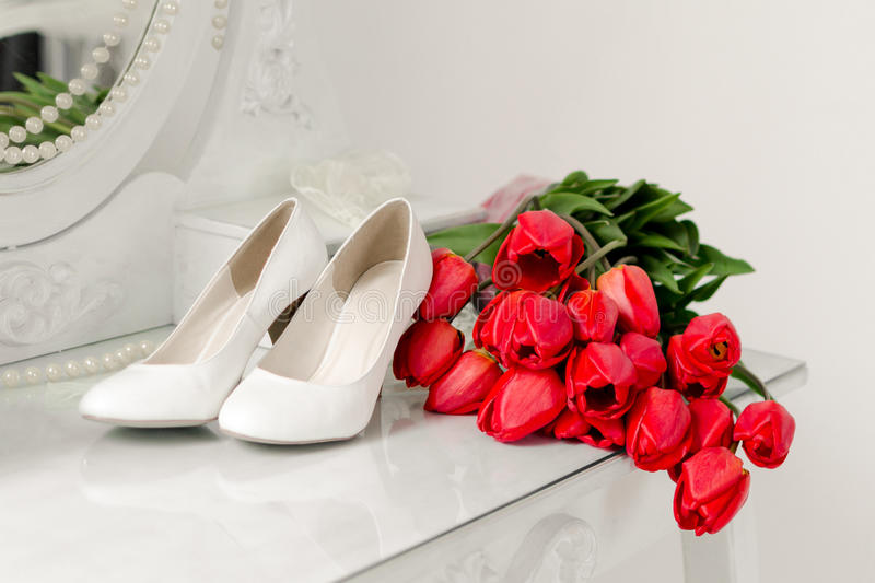 Tulips and shoes stock photos