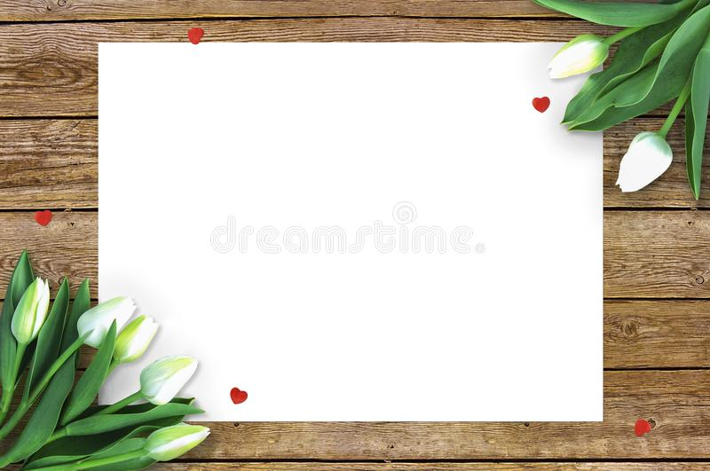 Tulips on wooden background with space for message. Mother`s Day background. Flowers on rustic table for March 8 royalty free stock images