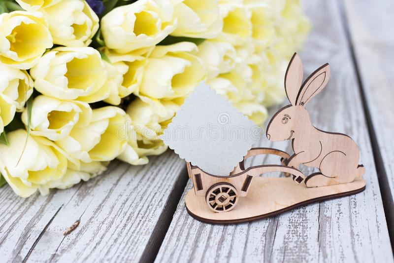 Tulips, wooden rabbit, place for text royalty free stock images