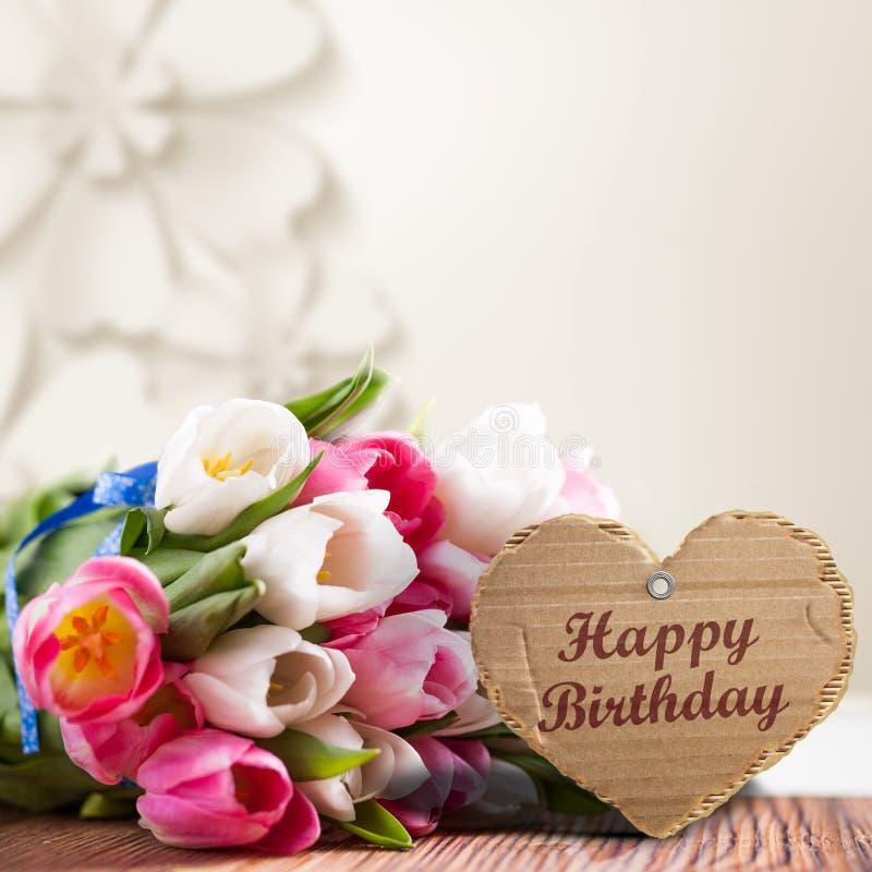 Tulpan med meddelandet som säger ` för lycklig födelsedag för `, royaltyfri illustrationer