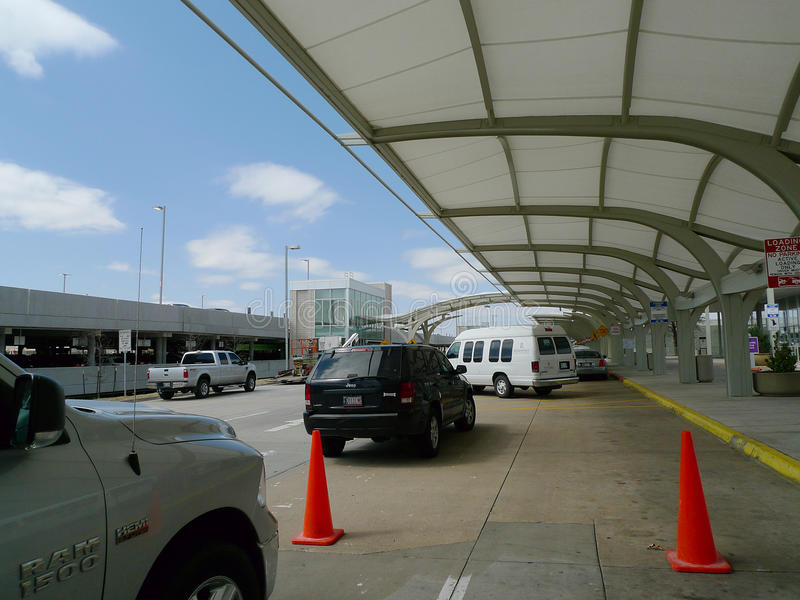 Tulsa International Airport exterior daytime, vehicles in drop off lane. Tulsa, Oklahoma airport, located at 7777 East Apache, Tulsa, Oklahoma. Flights within royalty free stock photo