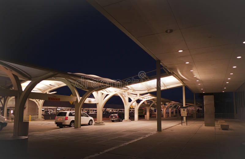 Tulsa International Airport exterior at night. Tulsa, Oklahoma airport, located at 7777 East Apache, Tulsa, Oklahoma. Flights within the United States with stock image