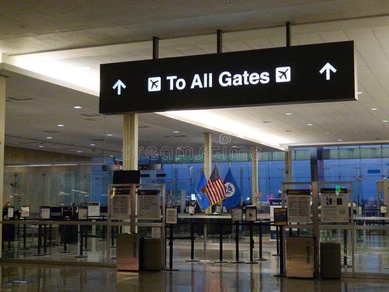 Tulsa International Airport signage, to all gates, TSA area, American Flag. Tulsa, Oklahoma airport, located at 7777 East Apache, Tulsa, Oklahoma. Flights royalty free stock photo