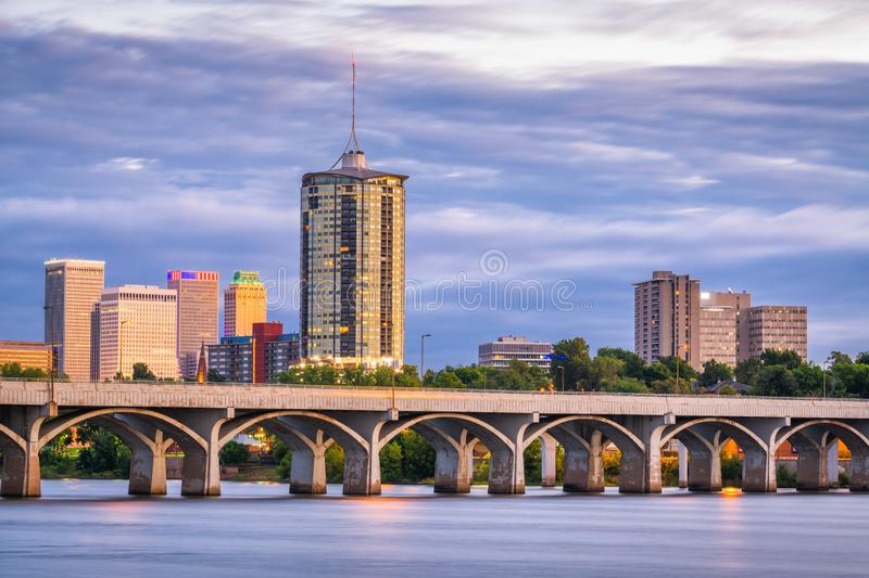 Tulsa, Oklahoma, USA. Downtown skyline on the Arkansas River at dusk royalty free stock image