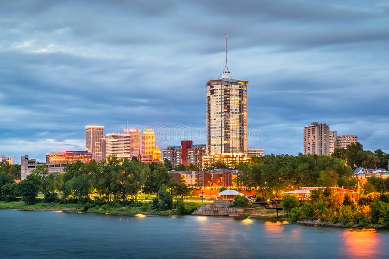 Tulsa, Oklahoma, USA. Downtown skyline on the Arkansas River at dusk royalty free stock photo