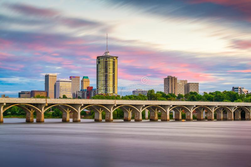Tulsa, Oklahoma, USA downtown skyline on the Arkansas River at dusk.  royalty free stock images