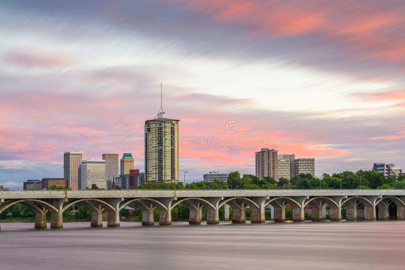Tulsa, Oklahoma, USA. Downtown skyline on the Arkansas River at dusk royalty free stock images