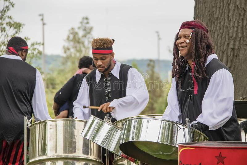 Gemstar Caribbean Steel Band playing outdoors at the opening of the free Gathering Place park stock photos