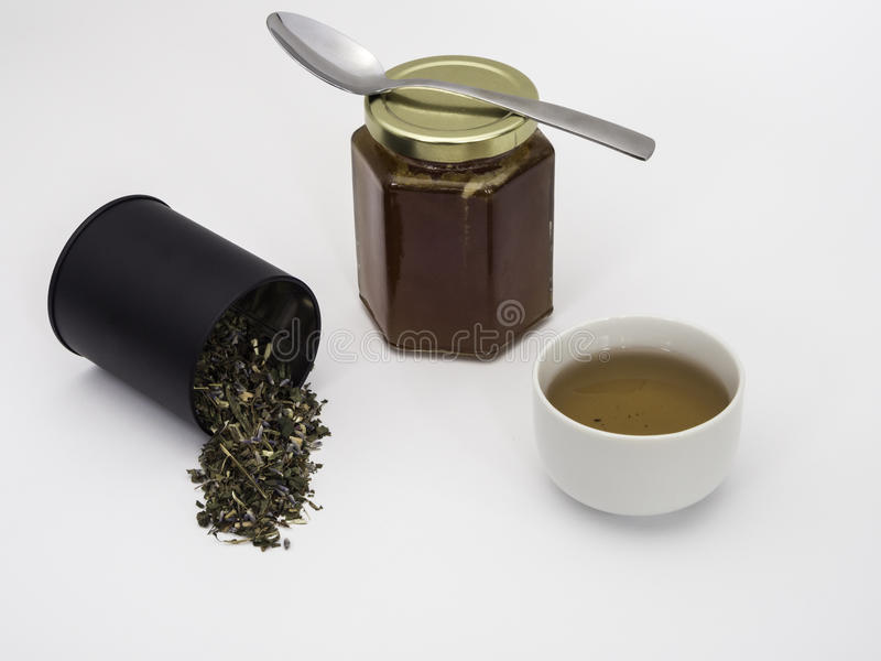 Tulse mit Honey Jar und Tasse Tee stockfotografie